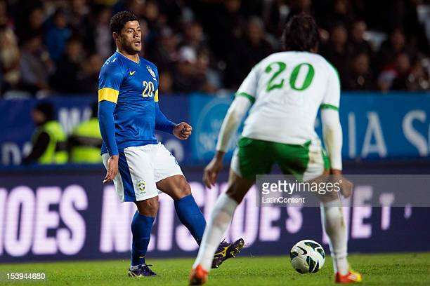 Hulk of Brazil and Muthana Khalid of Iraq fight for the ball during a FIFA friendly match between Brazil and Iraq at Swedbank Stadium on October 10...