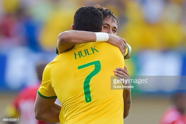Hulk of Brazil celebrates with team mate Neymar after scoring a goal during the International Friendly Match between Brazil and Panama at Serra...