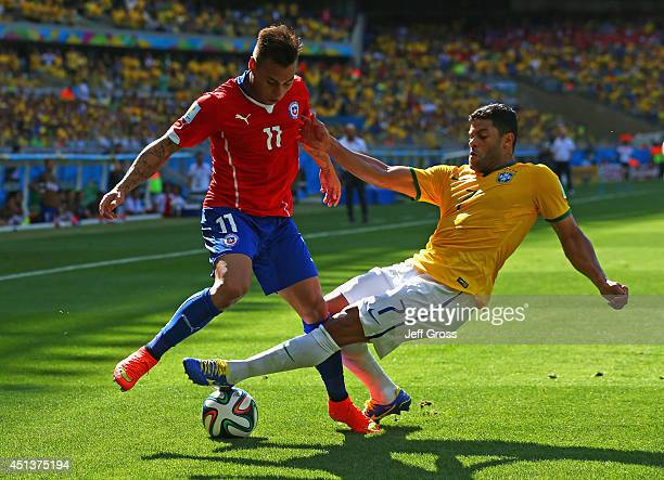 Hulk of Brazil challenges Eduardo Vargas of Chile during the 2014 FIFA World Cup Brazil round of 16 match between Brazil and Chile at Estadio...