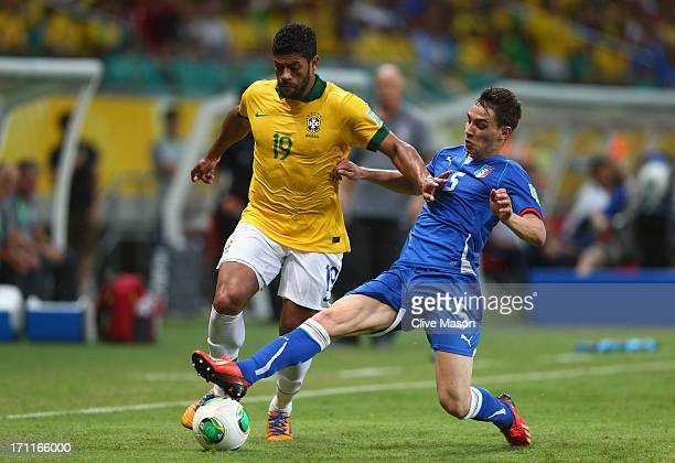 Hulk of Brazil competes with Mattia De Sciglio of Italy during the FIFA Confederations Cup Brazil 2013 Group A match between Italy and Brazil at...