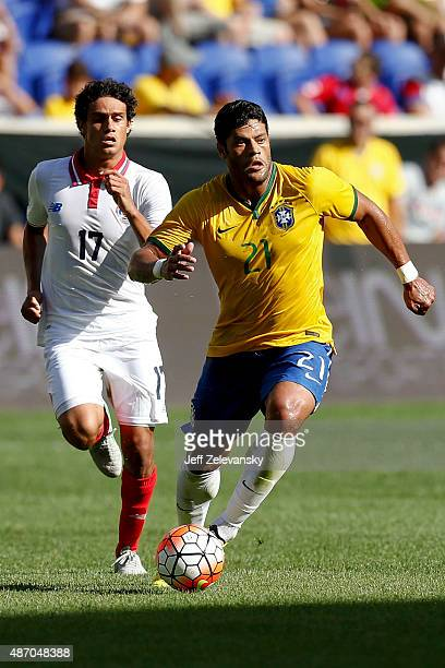 Hulk of Brazil drives by Yeltsin Tejeda of Costa Rica during their match at Red Bull Arena on September 5 2015 in Harrison New Jersey
