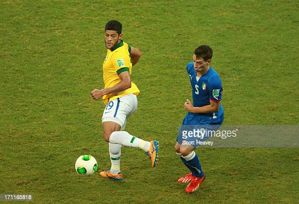 Hulk of Brazil is marked by Mattia De Sciglio of Italy during the FIFA Confederations Cup Brazil 2013 Group A match between Italy and Brazil at...