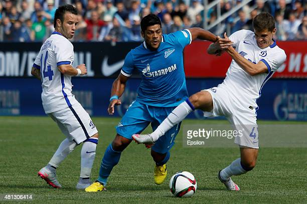Hulk of FC Zenit St Petersburg vies for the ball with Mathieu Valbuena of FC Dinamo Moscow and Roman Zobnin of FC Dinamo Moscow during the Russian...