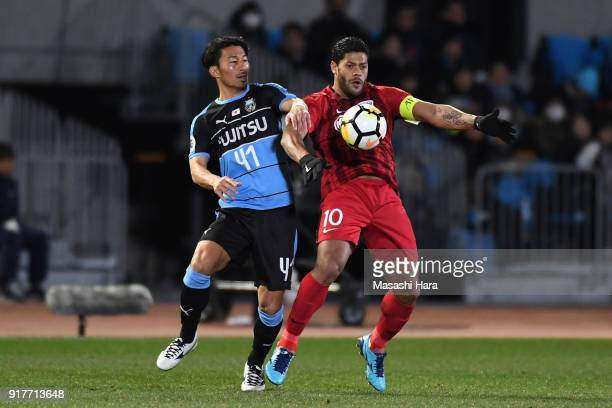 Hulk of Shanghai SIPG and Akihiro Ienaga of Kawasaki Frontale compete for the ball during the AFC Champions League Group F match between Kawasaki...