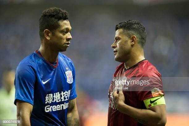 Hulk of Shanghai SIPG and Fredy Guarin of Shanghai Greenland Shenhua in action during the 2018 Chinese Super League match between Shanghai Greenland...