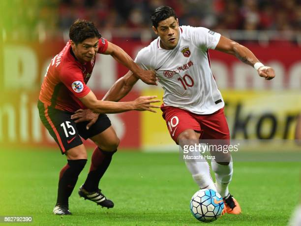 Hulk of Shanghai SIPG and Kazuki Nagasawa of Urawa Red Diamonds compete for the ball during the AFC Champions League semi final second leg match...