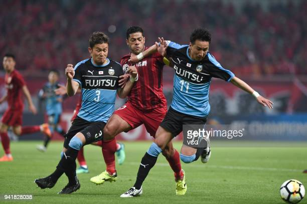 Hulk of Shanghai SIPG and Yu Kobayashi of Kawasaki Frontale compete for the ball during AFC Champions League Group F match between Shanghai SIPG and...
