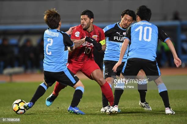 Hulk of Shanghai SIPG controls the ball under pressure of Kawasaki Frontale defense during the AFC Champions League Group F match between Kawasaki...