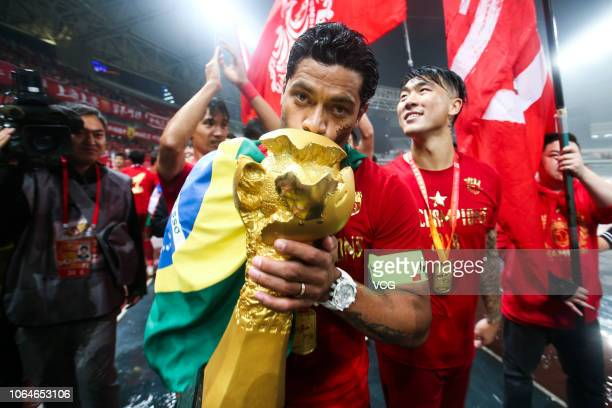 Hulk of Shanghai SIPG kisses the trophy during the award ceremony of the 2018 Chinese Super League 29th round match between Shanghai SIPG and Beijing...