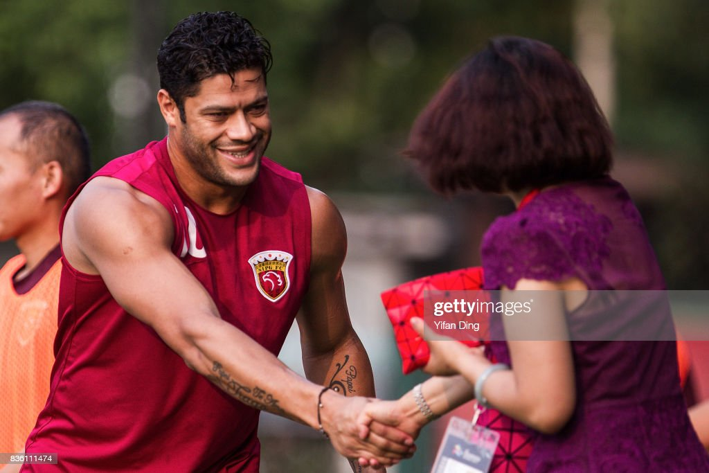 Hulk of Shanghai SIPG shakes hand with Shanghai SIPG officer during pre-match training session of the AFC Champions League 2017 Quarterfinals 1st leg between Shanghai SIPG v Guangzhou Evergrande at Shanghai Stadium on August 21, 2017 in Shanghai, China.