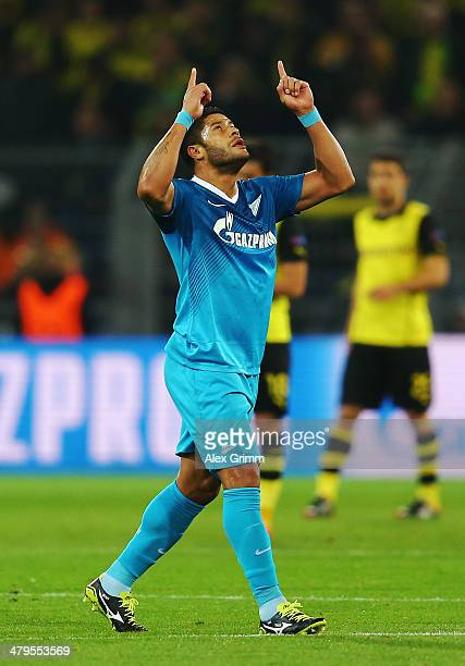 Hulk of Zenit celebrates scoring the opening goal during the UEFA Champions League round of 16 second leg match between Borussia Dortmund and FC...