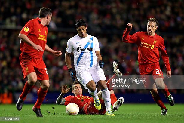Hulk of Zenit charges through the liverpool defence of Jamie Carragher Daniel Agger and Lucas of Liverpool during the UEFA Europa League round of 32...