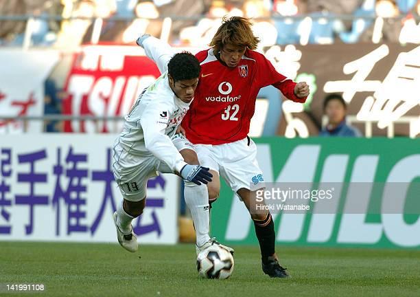 Hulk whose real name is Givanildo Vieira de Souza of Kawasaki Frontale and Hajime Hosogai of Urawa Red Diamonds compete for the ball during the 85th...