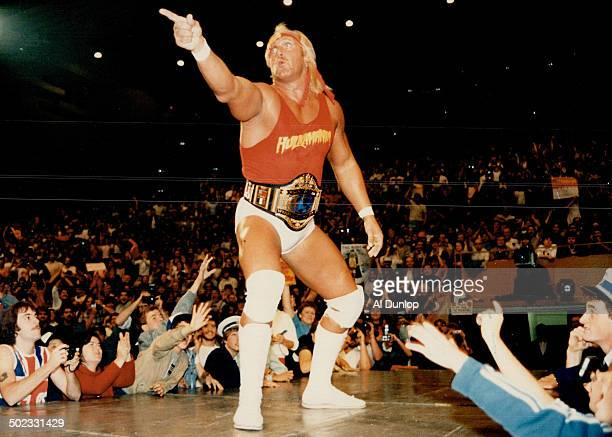 Hulking defiance Hulk Hogan all 6foot7 inches and 307 pounds of him stands before his adoring audience at Maple Leaf Gardens last night before a...