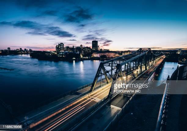hull bridge on ottawa river (dusk) - gatineau stock pictures, royalty-free photos & images