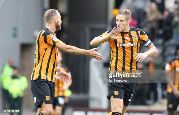 Hull captain Michael Dawson congratulates David Myler on scoring the equalising goal during the Sky Bet Championship match between Hull City and...