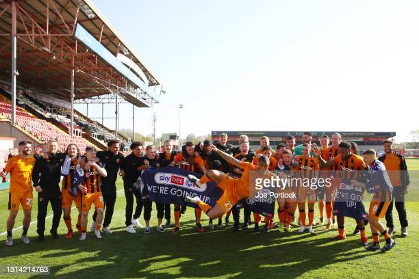 Hull city celebrate after wining promotion following the Sky Bet League One match between Lincoln City and Hull City at Sincil Bank Stadium on April...
