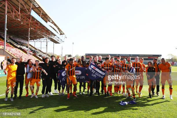 Hull City celebrate during the Sky Bet League One match between Lincoln City and Hull City at Sincil Bank Stadium on April 24, 2021 in Lincoln,...