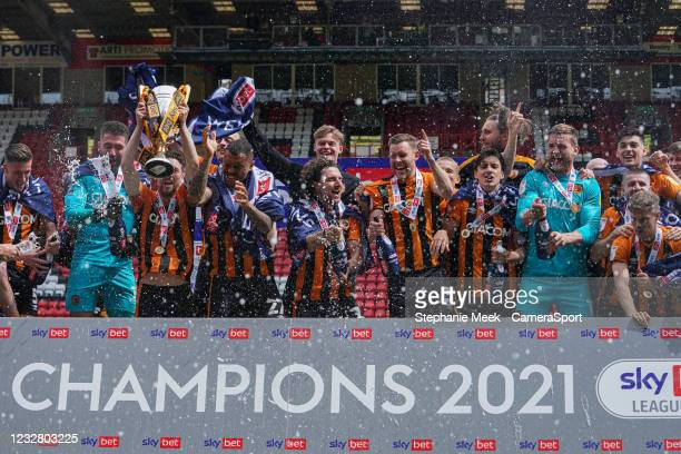 Hull City celebrate winning League One during the Sky Bet League One match between Charlton Athletic and Hull City at The Valley on May 9, 2021 in...