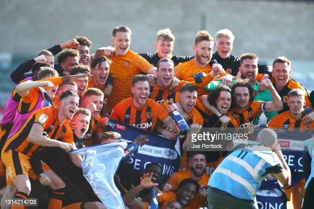 Hull City celebrate winning promotion during the Sky Bet League One match between Lincoln City and Hull City at Sincil Bank Stadium on April 24, 2021...