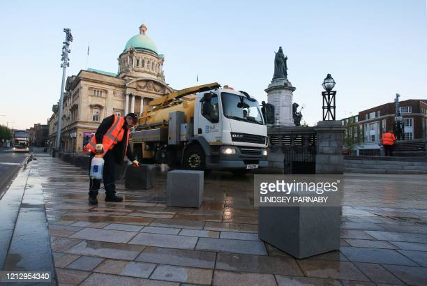 Hull City Council workers disinfect the public footpaths and structures to guard against the transmission of COVID19 in the city centre of...