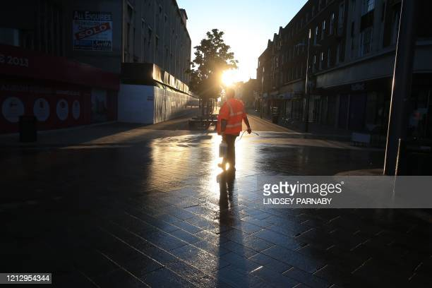 Hull City Council workers disinfect the public footpaths and structures to guard against the transmission of COVID-19 in the city centre of...