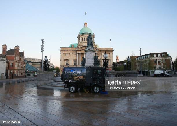 Hull City Council workers use street sweepers as they disinfects the public footpaths and structures to guard against the transmission of COVID-19 in...