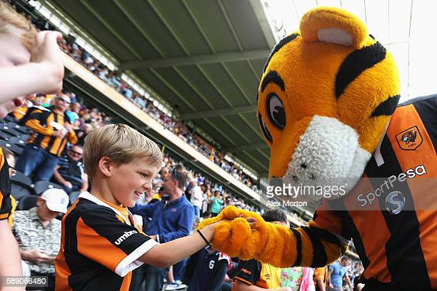 Hull City fan engages with the mascot during the Premier League match between Hull City and Leicester City at KCOM Stadium on August 13 2016 in Hull...