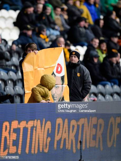 Hull City fans hold up a banner venting their frustrations at owner Assem Allam and vicechairman Ehab Allam during the Sky Bet Championship match...