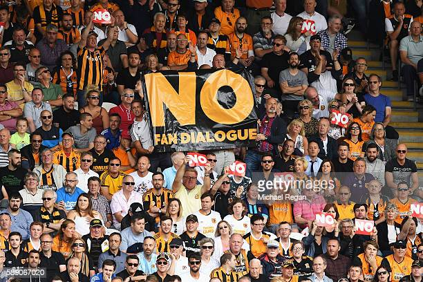 Hull City fans hold up NO signs and banners in protest during the Premier League match between Hull City and Leicester City at KCOM Stadium on August...