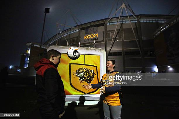 Hull City fans play with a ball outside the ground prior to the Premier League match between Hull City and Everton at KCOM Stadium on December 30...