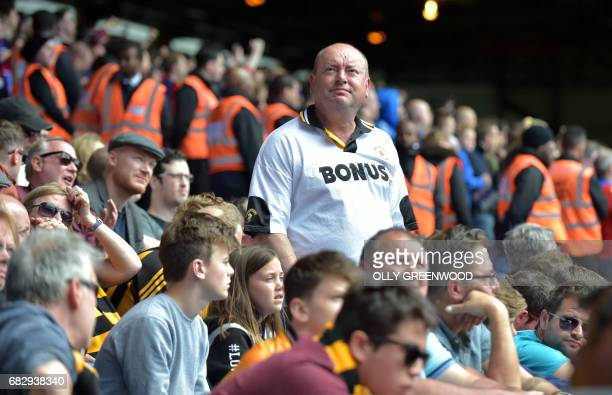 Hull City fans react after the English Premier League football match between Crystal Palace and Hull City at Selhurst Park in south London on May 14...