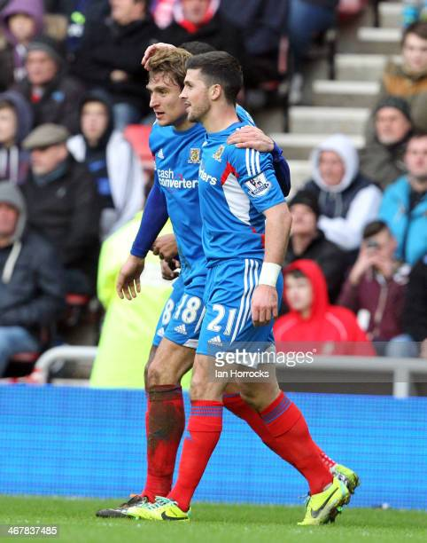 Hull City goalscorers Shane Long and Nikica Jelavic celebrate the second Hull goal during the Barclays Premier League match between Sunderland and...