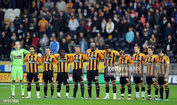 Hull City line up to pay their respects ahead of Remembrance Day prior to the npower Championship match between Hull City and West Ham United at KC...