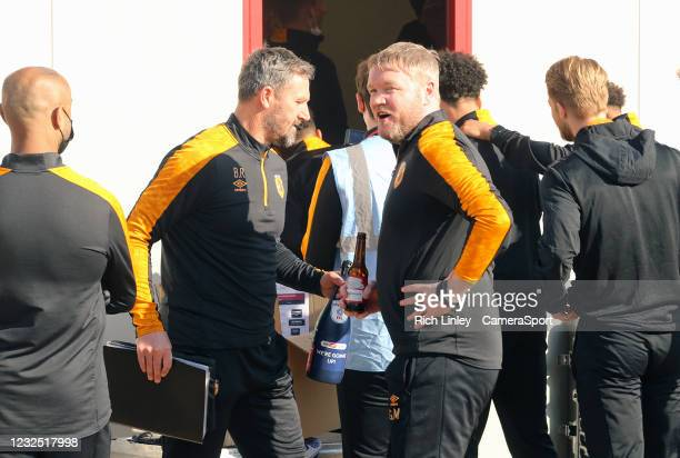 Hull City manager Grant McCann celebrates with his players and coaching staff at the final whistle as his side are promoted to The Championship...