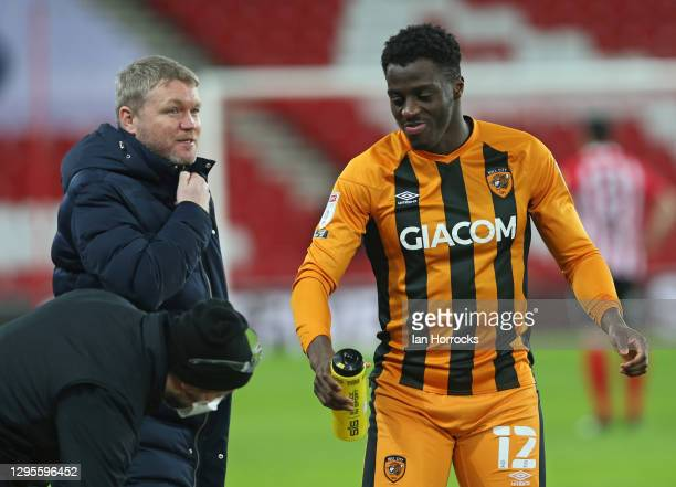 Hull City manager Grant McCann talks to Josh Emmanuel during the Sky Bet League One match between Sunderland and Hull City at Stadium of Light on...