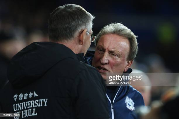 Hull City manager Nigel Adkins shakes hands with Cardiff City manager Neil Warnock prior to kick off of the Sky Bet Championship match between...