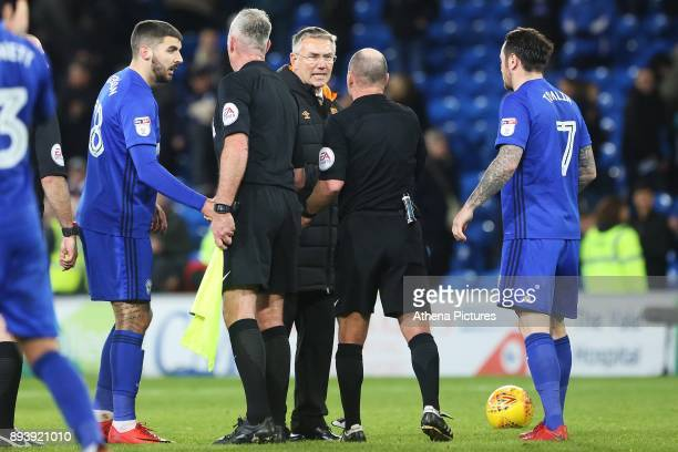 Hull City manager Nigel Adkins shakes hands with referee S Duncan after the final whistle of the Sky Bet Championship match between Cardiff City and...