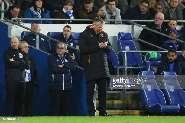 Hull City manager Nigel Adkins takes notes during the Sky Bet Championship match between Cardiff City and Hull City at the Cardiff City Stadium on...