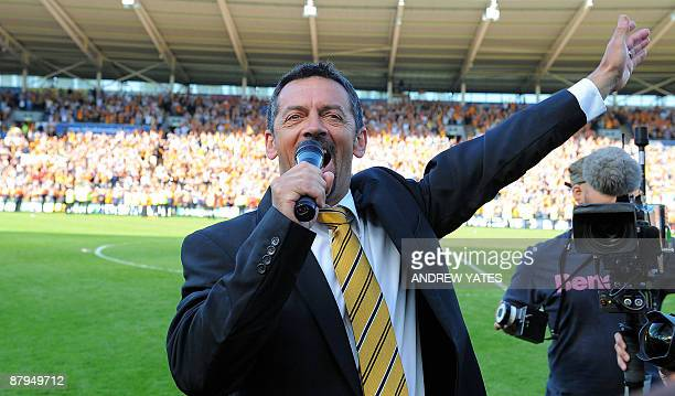 Hull City manager Phil Brown celebrates by singing with the supporters on the pitch after his team avoid religation after the English Premier League...