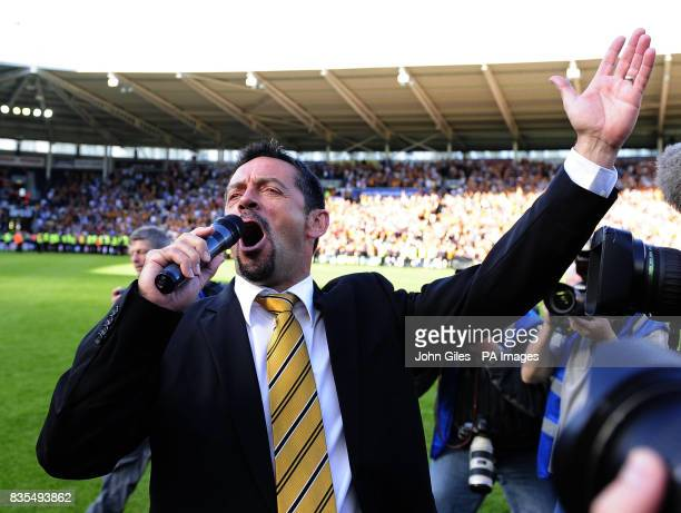 Hull City manager Phil Brown sings to the fans after the final whistle during the Barclays Premier League match at the KC Stadium, Hull.