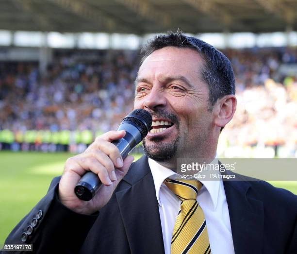 Hull City manager Phil Brown sings to the fans at the final whistle after his side avoided relegation during the Barclays Premier League match at the...