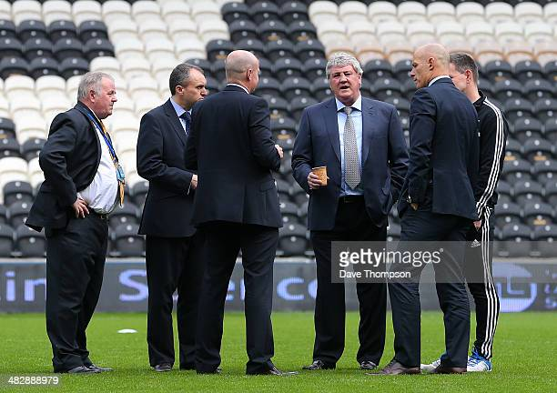 Hull City manager Steve Bruce talks to the match officials on the pitch before the Barclays Premier League match between Hull City and Swansea City...