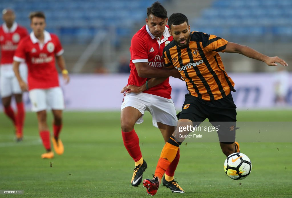 Hull City midfielder Kevin Stewart with Benfica's midfielder Joao Carvalho from Portugal in action during the Algarve Cup match between SL Benfica and Hull City at Estadio Algarve on July 22, 2017 in Faro, Portugal.