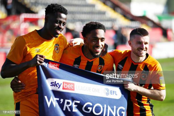 Hull City Players celebrate during the Sky Bet League One match between Lincoln City and Hull City at Sincil Bank Stadium on April 24, 2021 in...