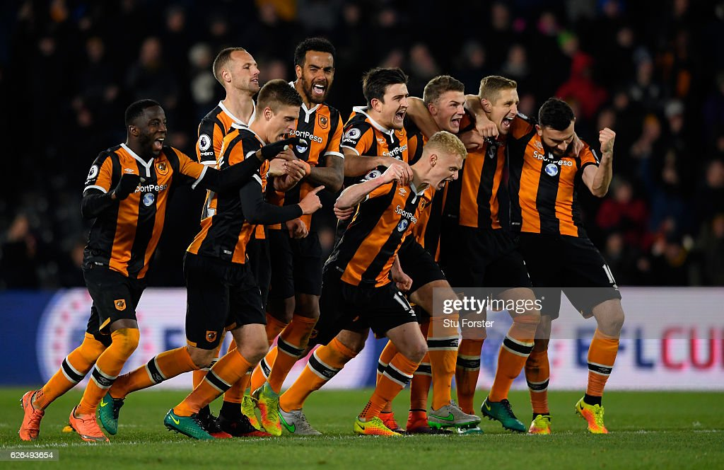 Hull City players celebrate following victory in the penalty shoot out after the EFL Cup Quarter-Final match between Hull City and Newcastle United at KCOM Stadium on November 29, 2016 in Hull, England.