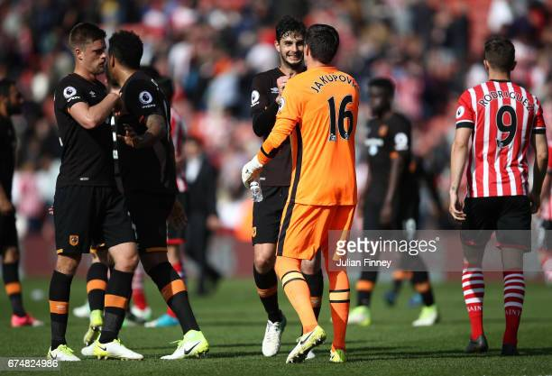 Hull City players celebrate with Eldin Jakupovic of Hull City after the full timw whistle during the Premier League match between Southampton and...
