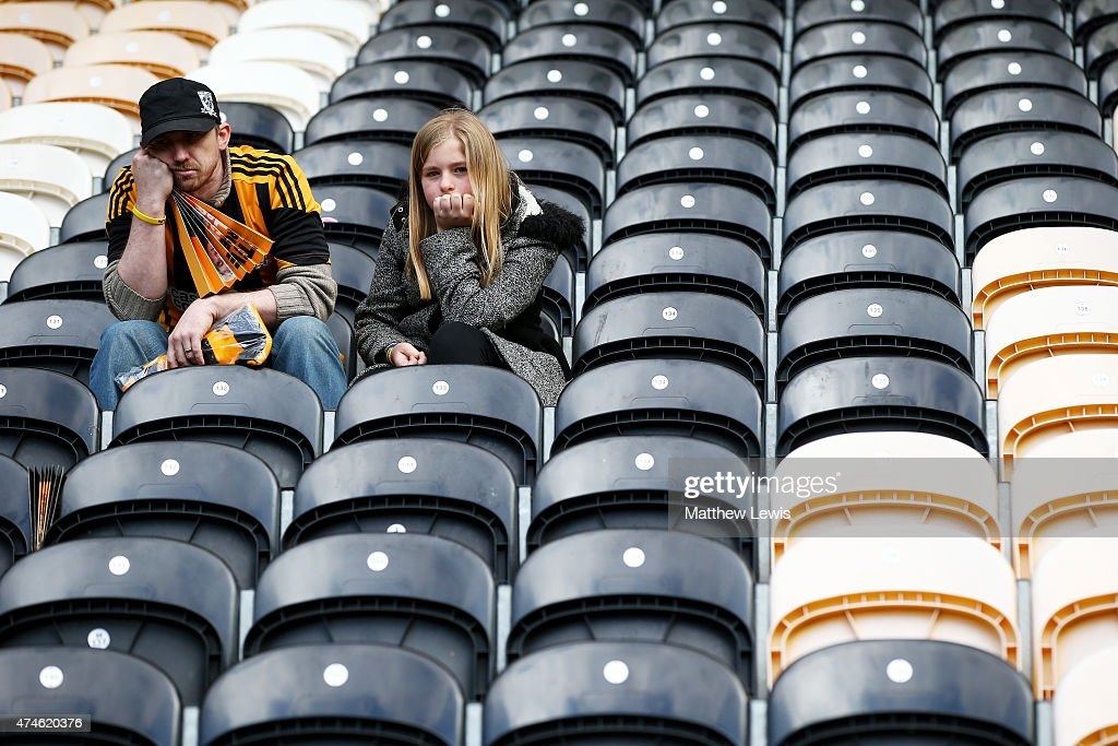 Hull City supporters show their dejection after their team was relegated from the Premier League after the Barclays Premier League match between Hull City and Manchester United at KC Stadium on May 24, 2015 in Hull, England.