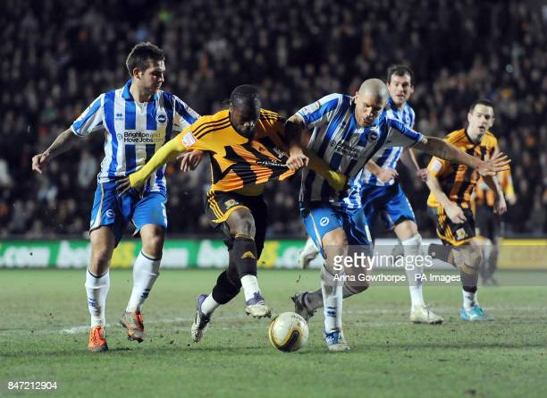 Hull City's Aaron Mclean has his shirt pulled by Brighton Hove Albion's Adam ElAbd during the npower Football League Championship match at the KC...