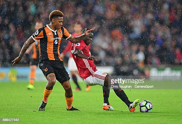 Hull City's Abel Hernandez is tackled by Manchester United's Eric Bailly during the Premier League match between Hull City and Manchester United at...
